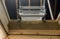 Loft ladder in the stowed position