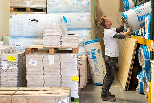 installer lifting materials in warehouse