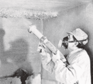 asbestos being applied by worker