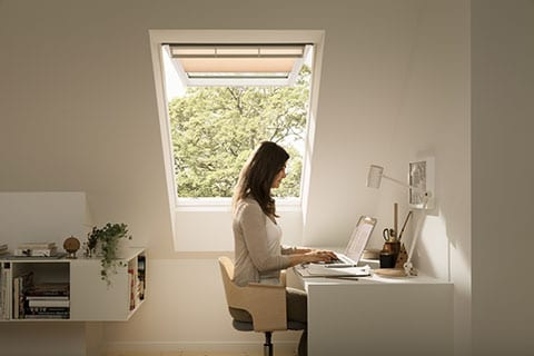 top hung roof window with woman working